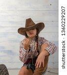 a little girl in a wide brimmed ... | Shutterstock . vector #1360229207