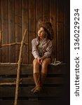 little girl in a wide brimmed... | Shutterstock . vector #1360229234
