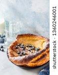 dutch baby with blueberries ... | Shutterstock . vector #1360246001