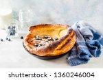 dutch baby with blueberries ... | Shutterstock . vector #1360246004