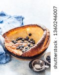 dutch baby with blueberries ... | Shutterstock . vector #1360246007