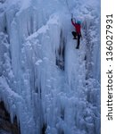 Alpinist Ascenting A Frozen...