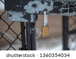 padlock lock on fence gate... | Shutterstock . vector #1360354034