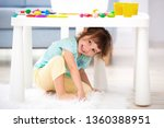 little cute girl crawled under... | Shutterstock . vector #1360388951