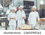 a group of bakers smiles at the ... | Shutterstock . vector #1360398161