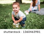 little boy play with ball on... | Shutterstock . vector #1360463981