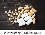 many different pills on dark... | Shutterstock . vector #1360566884