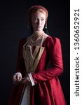 Small photo of Tudor woman in red dress
