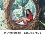pretty asian woman is sitting... | Shutterstock . vector #1360687571
