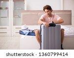 man with suitcase in bedroom...   Shutterstock . vector #1360799414