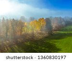 trees on a meadow in morning... | Shutterstock . vector #1360830197