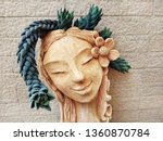 A Clay Head Planter With...