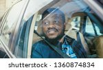 handsome young black man rides... | Shutterstock . vector #1360874834