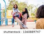 happy arabian family having fun ... | Shutterstock . vector #1360889747