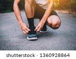 runners tied in shoes man run... | Shutterstock . vector #1360928864