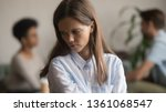 Small photo of Sad jealous young girl feeling betrayed by unfaithful cheating ex boyfriend liar caught having affair with other woman, upset lonely girlfriend alone rejected suffer from break up, bad relationship