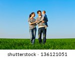 young happy family at outdoors | Shutterstock . vector #136121051