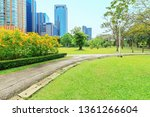 pathway through green trees at... | Shutterstock . vector #1361266604