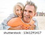 beautiful happy senior couple... | Shutterstock . vector #1361291417