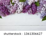 colored lilac flowers on wooden ...   Shutterstock . vector #1361306627