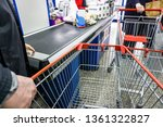 old man putting goods on... | Shutterstock . vector #1361322827