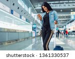 black female tourist in... | Shutterstock . vector #1361330537