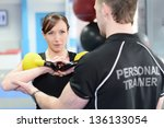 young woman working out with... | Shutterstock . vector #136133054