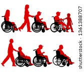 silhouettes disabled in a wheel ... | Shutterstock .eps vector #1361388707