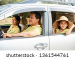 cheerful family in car | Shutterstock . vector #1361544761