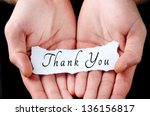 Small photo of Man holding thank you word in palm