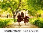 Two Little Monks Running...