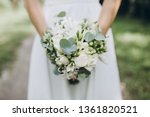 bride in white dress holding a... | Shutterstock . vector #1361820521