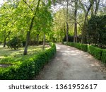 hedgerow and footpath in a park | Shutterstock . vector #1361952617