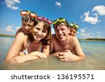 photo of happy family of divers ... | Shutterstock . vector #136195571