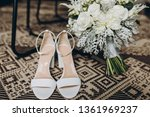 white shoes of the bride stand... | Shutterstock . vector #1361969237