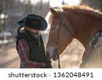 woman horseback riding | Shutterstock . vector #1362048491