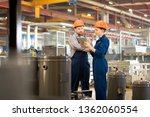 young engineers in overalls and ... | Shutterstock . vector #1362060554