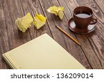 notepad on a wooden table with... | Shutterstock . vector #136209014