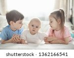 children lie on the bed next to ... | Shutterstock . vector #1362166541