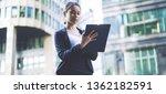 serious female trader dressed...   Shutterstock . vector #1362182591