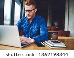 concentrated male freelancer... | Shutterstock . vector #1362198344