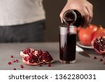 male hand pouring pomegranate... | Shutterstock . vector #1362280031
