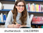 female student in a library | Shutterstock . vector #136238984