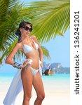 beautiful woman on the beach.... | Shutterstock . vector #136241201