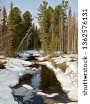 A Small Taiga River Thawed Out...