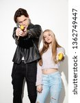 Small photo of Smash outright. Close up fashion portrait of two young cool hipster girl and boy wearing jeans wear. Studio shot of two models having fun and making serious faces.