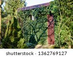 the building in the garden is... | Shutterstock . vector #1362769127