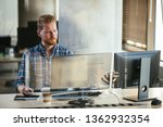 office worker on his computer.... | Shutterstock . vector #1362932354
