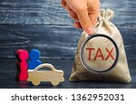 Small photo of A bag with money and the word Tax and a car with family. Concept the taxes payment for auto. Vehicle, road, disc tax. Is an annual tax that is levied as an excise duty and which must be paid