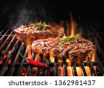 Beef Steaks Sizzling On The...